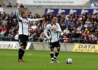 Pictured: (L-R) Mark Gower and Leon Britton of Swansea City in action <br />