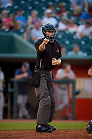 Umpire Jae-Young Kim calls a strike during a Midwest League game betwee the Burlington Bees ad Lansing Lugnuts on July 18, 2019 at Cooley Law School Stadium in Lansing, Michigan.  Lansing defeated Burlington 5-4.  (Mike Janes/Four Seam Images)