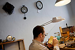 Florian Wullemann, watchmaker, repairs an antique clock in his boutique-workshop 'L'Horlogerie', Vence, France, 17 November 2010