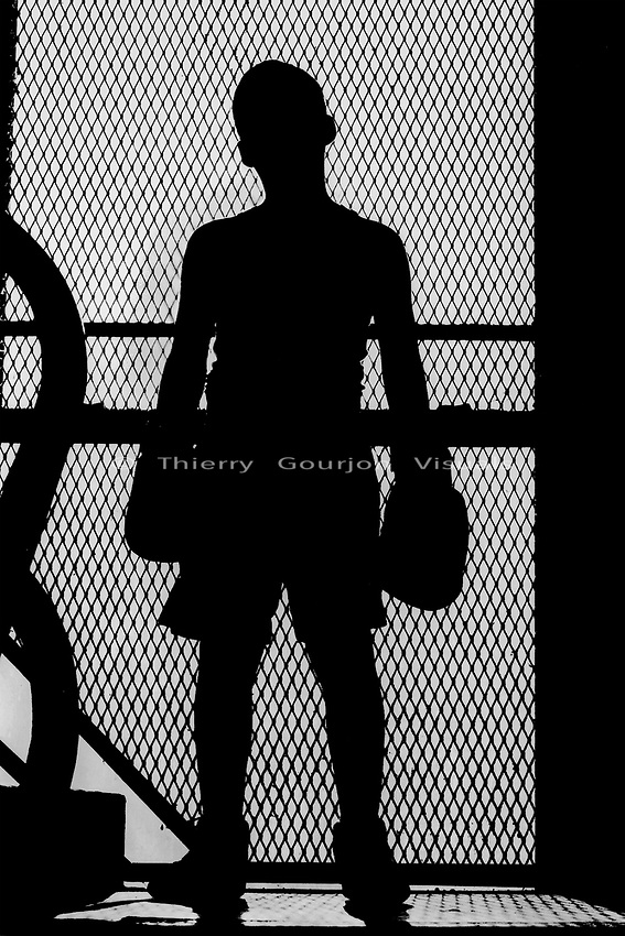A young fighter poses in Gleason's Gym's old stairwell in Brooklyn, New York  <br />Photo by Thierry Gourjon-Bieltvedt 2001.