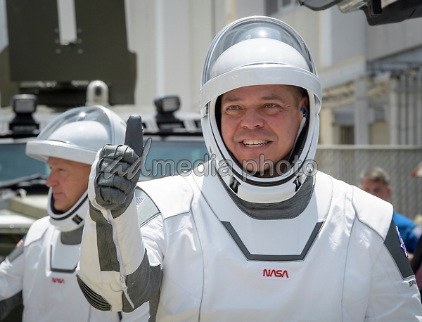 In this photo released by the National Aeronautics and Space Administration (NASA), NASA astronauts Robert Behnken, foreground, and Douglas Hurley, wearing SpaceX spacesuits, are seen as they depart the Neil A. Armstrong Operations and Checkout Building for Launch Complex 39A to board the SpaceX Crew Dragon spacecraft for the Demo-2 mission launch, Saturday, May 30, 2020, at NASA's Kennedy Space Center in Florida. NASA's SpaceX Demo-2 mission is the first launch with astronauts of the SpaceX Crew Dragon spacecraft and Falcon 9 rocket to the International Space Station as part of the agency's Commercial Crew Program. The test flight serves as an end-to-end demonstration of SpaceX's crew transportation system. Behnken and Hurley are scheduled to launch at 3:22 p.m. EDT on Saturday, May 30, from Launch Complex 39A at the Kennedy Space Center. A new era of human spaceflight is set to begin as American astronauts once again launch on an American rocket from American soil to low-Earth orbit for the first time since the conclusion of the Space Shuttle Program in 2011. <br /> Mandatory Credit: Bill Ingalls / NASA via CNP/AdMedia