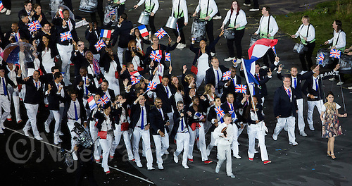 27 JUL 2012 - LONDON, GBR - Fencing competitor Laura Flessel-Colovic (FRA) leads the team from France into the Olympic Stadium during the Opening Ceremony of the London 2012 Olympic Games in Stratford, London, Great Britain (PHOTO (C) 2012 NIGEL FARROW)