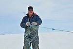 Commercial fisherman Roger Buckley checking his net on Great Slave Lake
