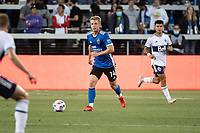 SAN JOSE, CA - AUGUST 13: Jackson Yueill #14 of the San Jose Earthquakes dribbles the ball during a game between San Jose Earthquakes and Vancouver Whitecaps at PayPal Park on August 13, 2021 in San Jose, California.