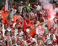 Security try to stop a Polish fan with a flare. Poland defeated Costa Rica 2-1 in their FIFA World Cup Group A match at FIFA World Cup Stadium, Hanover, Germany, June 20, 2006.