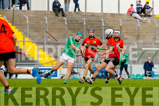 Kieran O'Carroll, Ballyduff, in action against Seimi Ó Fuarain, Ballyheigue, during the Kerry County Minor Hurling Championship Final match between Ballyduff and Ballyheigue at Austin Stack Park in Tralee, Kerry.