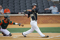 Justin Yurchak (20) of the Wake Forest Demon Deacons follows through on his swing against the Miami Hurricanes at Wake Forest Baseball Park on March 22, 2015 in Winston-Salem, North Carolina.  The Demon Deacons defeated the Hurricanes 10-4.  (Brian Westerholt/Four Seam Images)