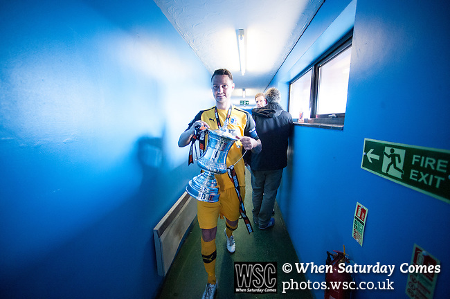 Lowestoft Town 2 Barrow 3, 25/04/2015. Crown Meadow, Conference North. Barrow make the six-hour trip to Suffolk needing a win to secure the title. Captain Simon Grand heads to the away changing room with the trophy. Photo by Simon Gill.