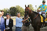 August 2, 2015. Trainer Bob Baffert, far left, is among connections gathered on the track with American Pharoah( Victor Espinoza up) after the colt's win in the  Grade I William Hill Haskell Invitational Stakes, one and 1/8 miles on the dirt  for three year olds at Monmouth Park in Oceanport, NJ. Bob Baffert is trainer; Ahmed Zayat is owner. The logo of sponsoring agent Monster Energy is on Espinoza's hat and American Pharoah's nose band. Joan Fairman Kanes/ESW/CSM