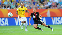Carli Lloyd (r) of team USA and Ester of team Brazil during the FIFA Women's World Cup at the FIFA Stadium in Dresden, Germany on July 10th, 2011.