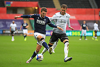 3rd October 2020; Liberty Stadium, Swansea, Glamorgan, Wales; English Football League Championship, Swansea City versus Millwall; Tom Bradshaw of Millwall and Joe Rodon of Swansea City jostles for possession