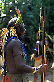Bacaja village, Amazon, Brazil. An Elder watches the young men starting the hornets' nest initiation ceremony; Xicrin tribe.