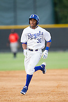 Christian Cano (30) of the Burlington Royals hustles towards third base against the Greeneville Astros at Burlington Athletic Park on June 29, 2014 in Burlington, North Carolina.  The Royals defeated the Astros 11-0. (Brian Westerholt/Four Seam Images)
