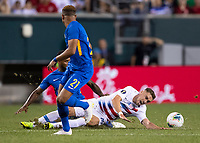 PHILADELPHIA, PA - JUNE 30: Tyler Boyd #21 is tackled from behind by Leandro Bacuna #10 during a game between Curaçao and USMNT at Lincoln Financial Field on June 30, 2019 in Philadelphia, Pennsylvania.
