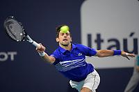 MIAMI GARDENS, FLORIDA - MARCH 22: Novak Djokovic of Serbia defeats Bernard Tomic of Australia during the Miami Open day 5 Presented by Itau at Hard Rock Stadium March 22, 2019 in Miami Gardens, Florida<br /> <br /> People: Novak Djokovic