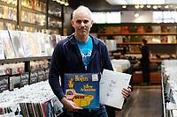 Magasins de musique : Vinyle ou disques compacts a Montreal, CANADA, Nov 2012<br /> <br /> Pierre Markotanyos, propriétaire de la boutique Aux 33 tours, située sur l'avenue Mont-Royal.