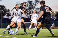 Texas State forward Kira Zapalac (23) is trapped by Texas defender Ali Schmalz (24) and forward Aaron Strawser (12) during an NCAA soccer game, Sunday, September 21, 2014 in San Marcos, Tex. Texas defeated Texas State 2-0. (Mo Khursheed/TFV Media via AP Images)