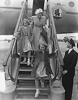 Princesses Irene and Beatrix have looked inside the plane in which Prince Bernhard is traveling. They are now walking down the flight of stairs. Keywords: airline Location: Schiphol; North Holland Date: May 29, 1949<br /> <br /> <br /> PHOTO :  Noske, J.D. / Anefo