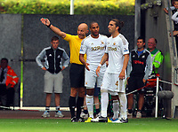 Saturday, 01 September 2012<br /> Pictured: Match referee Roger East (L) sends off Chico Flores of Swansea (R) while team mate Ashley Williams (L) tries to difuse the situation.<br /> Re: Barclays Premier League, Swansea City FC v Sunderland at the Liberty Stadium, south Wales.