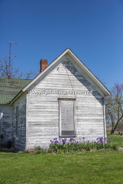 An old house sits in the country.
