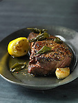 A strip steak roasted with brown butter, sage leaves, black pepper, lemon juice, and garlic.
