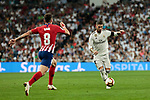 Real Madrid's Sergio Ramos and Atletico de Madrid's Saul Niguez during La Liga match between Real Madrid and Atletico de Madrid at Santiago Bernabeu Stadium in Madrid, Spain. September 29, 2018. (ALTERPHOTOS/A. Perez Meca)