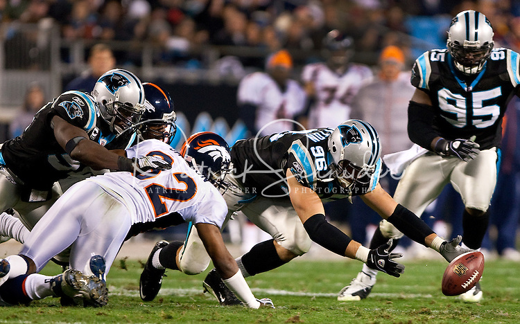 Carolina Panthers defensive end Tyler Brayton (96) dives for a loose ball against the Denver Broncos during an NFL football game at Bank of America Stadium in Charlotte, NC.