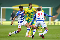 1st May 2021; Carrow Road, Norwich, Norfolk, England, English Football League Championship Football, Norwich versus Reading; Josh Laurent of Reading challenges Kieran Dowell of Norwich City