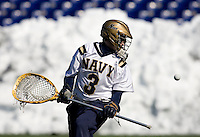 RJ Wickham (3) of Navy can only watch the ball as it falls into the net for a goal at the Navy-Marine Corp Memorial Stadium in Annapolis, Maryland.   Loyola defeated Navy, 8-7, in overtime.