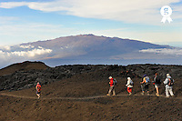 Hikers group going down Mauna Loa volcano, with Mauna Kea volcano in the background - Big Island, Hawaii<br />  (Licence this image exclusively with Getty: http://www.gettyimages.com/detail/85071268 )