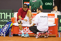 September 12, 2014, Netherlands, Amsterdam, Ziggo Dome, Davis Cup Netherlands-Croatia, Borna Coric get treatment on his foot(CRO)<br /> Photo: Tennisimages/Henk Koster