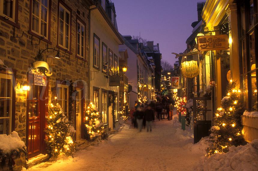 AJ0673, Canada, Quebec, Rue Petit Champlain in Quebec City is illuminated at night (evening) in winter.
