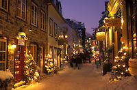 AJ0673, Canada, Quebec, Rue Petit Champlain in Quebec City is illuminated at night (evening) in winter.