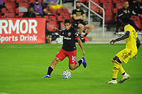 WASHINGTON, DC - OCTOBER 28: Edison Flores #10 of D.C. United plays the ball against Aboubacar Keita #30 of Columbus Crew SC during a game between Columbus Crew and D.C. United at Audi Field on October 28, 2020 in Washington, DC.