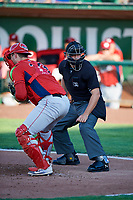 Harrison Wenson (23) of the Orem Owlz on defense against the Ogden Raptors, while home plate umpire Colin Baron makes the calls in Pioneer League action at Lindquist Field on June 21, 2017 in Ogden, Utah. The Owlz defeated the Raptors 16-5. This was Opening Night at home for the Raptors.  (Stephen Smith/Four Seam Images)