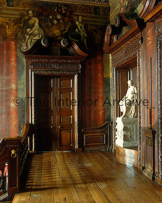 The landing at the top of The Grand Staircase at Powis Castle, the walls of which were decorated in 1705 by Gerard Lanscroon, a pupil of Verrio