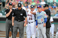 Tennessee Smokies manager Buddy Bailey #26 explains the ground rules to opposing manager Jody Reed #3 and the umpiring crew before  a game against the Chattanooga Lookouts  at Smokies Park on April 10, 2013 in Kodak, Tennessee. The Lookouts won 6-2. (Tony Farlow/Four Seam Images).