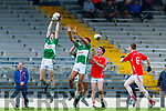 Ethan O'Neill makes a spectacular catch over team mate Jamie Alade Legion and Killian O'Sullivan East Kerry during their County Minor Championship semi final in Fitzgerald stadium on Monday evening
