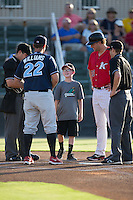 Dean Hooper (center) joins Kannapolis Intimidators manager Cole Armstrong (33) at home plate as he meets with Lakewood BlueClaws manager Shawn Williams (22), home plate umpire Lorenz Evans (left), and base umpire Sam Dodson prior to the start of their South Atlantic League game at Kannapolis Intimidators Stadium on August 11, 2016 in Kannapolis, North Carolina.  The Intimidators defeated the BlueClaws 3-1.  (Brian Westerholt/Four Seam Images)