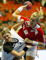 SERBIA, Novi Sad: Denmark's Susan Torp Thorsgaard (R) vies with Germany's Natalie Augsburg (L) during the Women's Handball World Championship 2013 quarter final match Denmark vs Germany on December 18, 2013 in Novi Sad.  AFP PHOTO / PEDJA MILOSAVLJEVIC