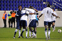 Connecticut Huskies players celebrate after defeating the Louisville Cardinals. Connecticut defeated Louisville 1-0 during the first semifinal match of the Big East Men's Soccer Championships at Red Bull Arena in Harrison, NJ, on November 11, 2011.