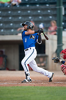 Missoula Osprey designated hitter Nick Dalesandro (8) follows through on his swing during a Pioneer League game against the Orem Owlz at Ogren Park Allegiance Field on August 19, 2018 in Missoula, Montana. The Missoula Osprey defeated the Orem Owlz by a score of 8-0. (Zachary Lucy/Four Seam Images)