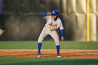 Ricardo Cespedes (32) of the Kingsport Mets shades his eyes from the sun as he takes his lead off of first base during the game against the Danville Braves at American Legion Post 325 Field on July 9, 2016 in Danville, Virginia.  The Mets defeated the Braves 10-8.  (Brian Westerholt/Four Seam Images)