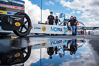 Jul 10, 2020; Clermont, Indiana, USA; Crew members stand alongside the dragster of NHRA top fuel driver Leah Pruett during testing for the Lucas Oil Nationals at Lucas Oil Raceway. This will be the first race back for NHRA since the COVID-19 pandemic. Mandatory Credit: Mark J. Rebilas-USA TODAY Sports
