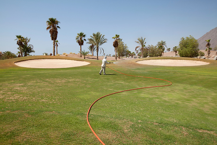 """Taba Heights, Sinai, July 2014. In the """"Taba Heights"""", most of the hotel chains share a golf course. Of which only one area is looked after while the rest of the course has been destroyed by the floods."""