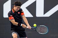 8th February 2021; Melbourne, Victoria, Australia;  Kei Nishikori of Japan returns the ball during round 1 of the 2021 Australian Open on February 8 2020, at Melbourne Park in Melbourne, Australia.