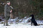 Pix: Shaun Flannery/shaunflanneryphotography.com...COPYRIGHT PICTURE>>SHAUN FLANNERY>01302-570814>>07778315553>>..19th December 2009................Brodsworth Shoot..A black Labrador retrieves a bird to a 'gun'