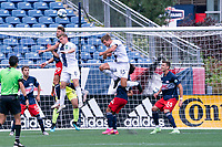 FOXBOROUGH, MA - JULY 4: Ryan Sierakowski #99 of the New England Revolution II heads the ball off a corner kick during a game between Greenville Triumph SC and New England Revolution II at Gillette Stadium on July 4, 2021 in Foxborough, Massachusetts.