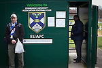 Edinburgh University 3 Selkirk 2, 13/03/2016. Peffermill, Scottish Lowland League. A 'groundhopper' posing for a photograph at the turnstile before watching Edinburgh University taking on Selkirk in a Scottish Lowland League match at Peffermill, Edinburgh in a game the hosts won 3-2. The match was one of six attended by members of GroundhopUK over the weekend to accommodate groundhoppers, fans who attempt to visit as many football venues as possible. Around 100 fans in two coaches from England participated in the 2016 Lowland League Groundhop and they were joined by other individuals from across the UK which helped boost crowds at the six featured matches. Photo by Colin McPherson.