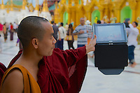 Changing Times - Monk with tablet iPad, Shwedagon Pagoda, Yangon